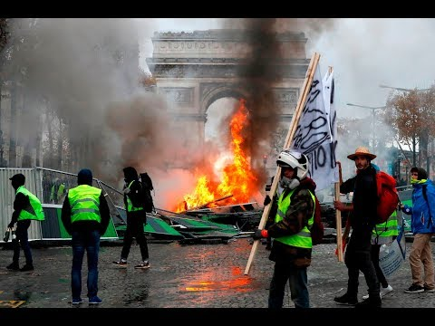 French police use teargas at protests over Macron, fuel taxes