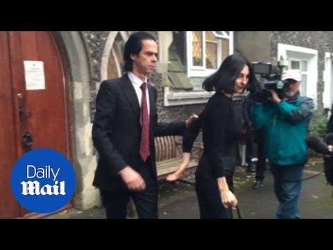 Nick Cave and Susie Bick leave inquest into death of son in 2015 - Daily Mail