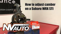 How to adjust camber and install camber bolts on a MacPherson strut car