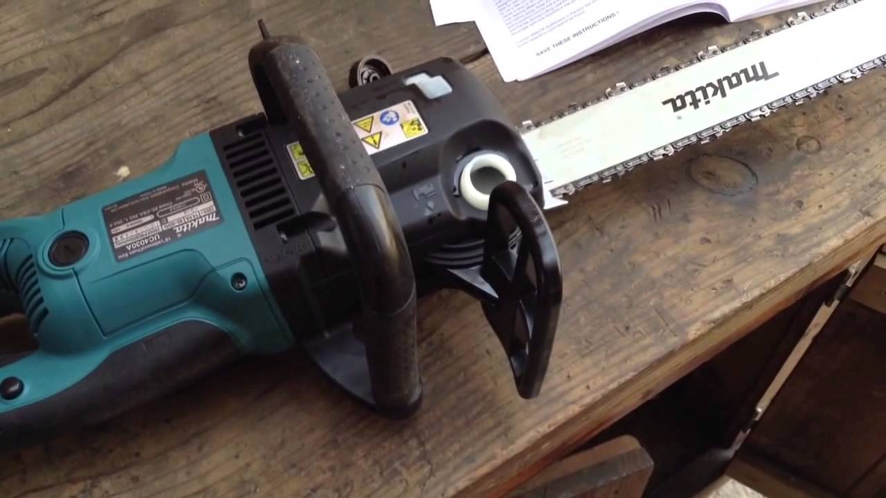 Makita uc4030a corded chainsaw unboxed assembly operation makita uc4030a corded chainsaw unboxed assembly operation review youtube greentooth Choice Image