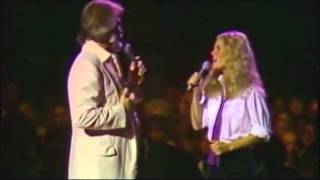 """Dont fall in love with a dreamer""-  Kenny Rogers & Kim Carnes."