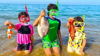 Children fishing for fish on the beach -ADEL ET SAMI