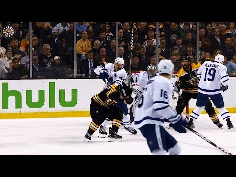 Marchand ducks, Rielly takes all of a Chara slap shot to face