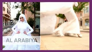 Eyewitness video has emerged showing a bride who was posing for photographs on her wedding day being swept away by the massive blast that shook beirut tue...