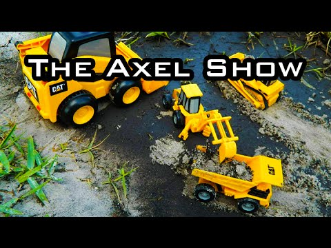 Digging With Toy Front Loaders, Skid Steers And Dump Trucks