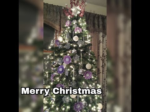 Christmas tree with lights on (with paper flowers)