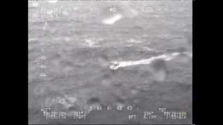 RESCUE CHOPPER FILMS SMALL BOAT IN BIG STORM