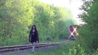 Strange Ottawa Girl walks along tracks on CN RAIL as a train approaches.