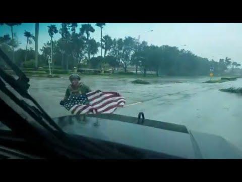 First Responder Saves Fallen American Flag During Hurricane Irma