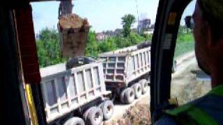 loading a gravel train with a Volvo EC 460 long reach excavator (part 2 pup trailer narrrated)