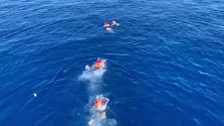 Desperate migrants jump overboard to reach Italy