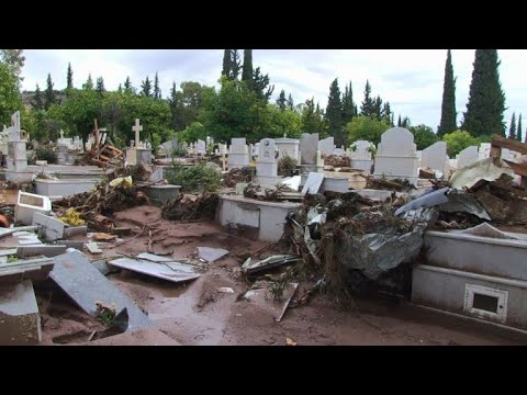Cemetery destroyed after flash floods in Greece