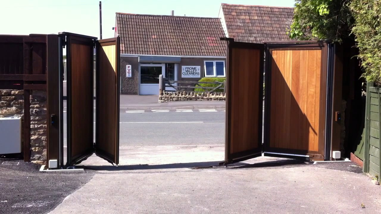 Automated Wooden Infill Bi Folding Gates Youtube