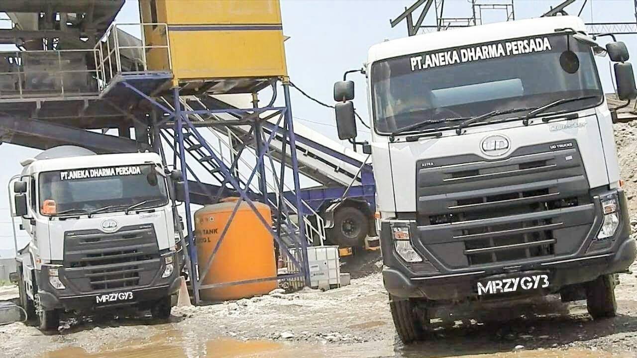 UD Trucks Quester Ready Mix Excavator Dump Truck Working On Dam Construction