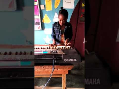 Rev Mrs Kenny Akins. Pst Lily Akins on the keyboard