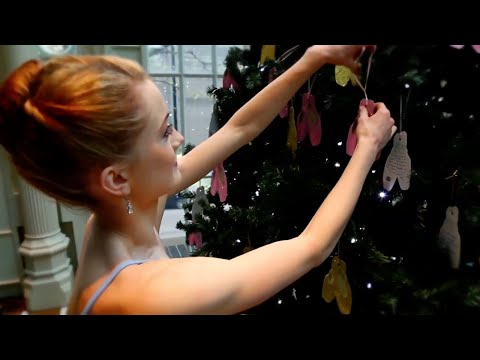 Royal Ballet Dancers decorate the Royal Opera House Christmas Tree