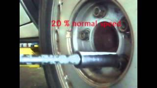 Impact gun installing lug nut with Torque stick Slo Mo