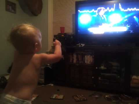 My baby dancing to Bon Jovi 12/12/12 concert. Lol
