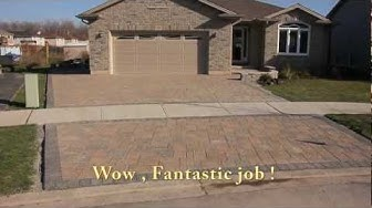Building a driveway with Stone Pavers video footage