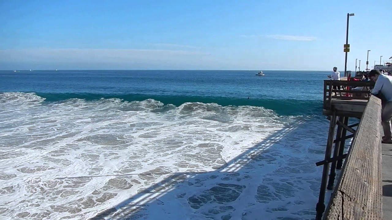 The Waves Were Crashing Along Balboa Pier In Newport Beach California