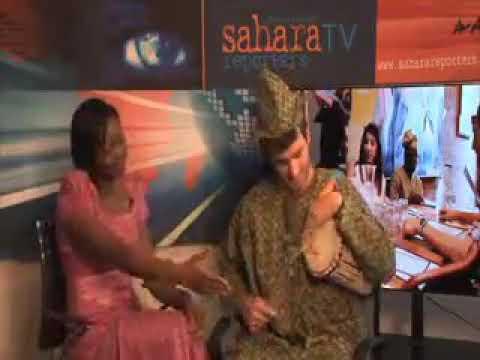 White Man Playing Nigeria Talking Drum