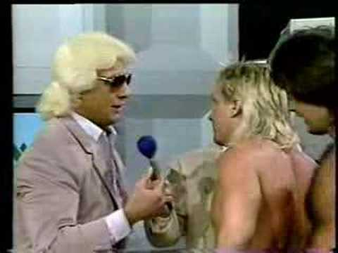 Ric Flair gives Ricky Morton a training bra