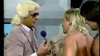 Ric Flair gives Ricky Morton a training bra thumbnail