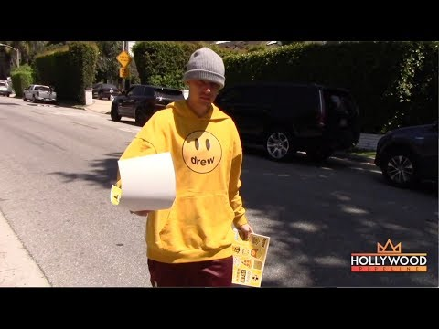 Justin Bieber Gives &39;DREW&39; Stickers to the Paparazzi
