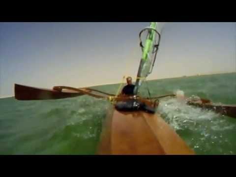 Kayak Sailing: Kayak sailing in Qatar. High speed Osprey Triple kayak with North windsurf sail.