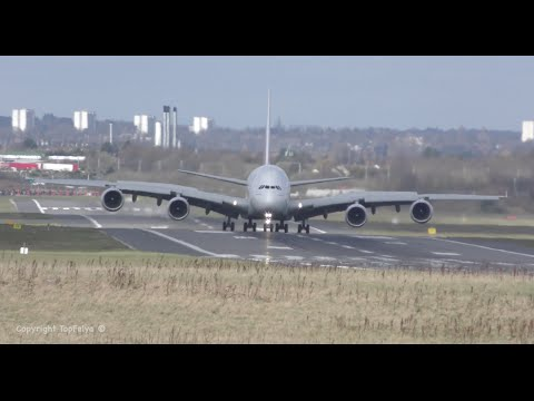 Stormy weather ! Airbus A380 Emirates Airline arriving at Birmingham airport during crosswind
