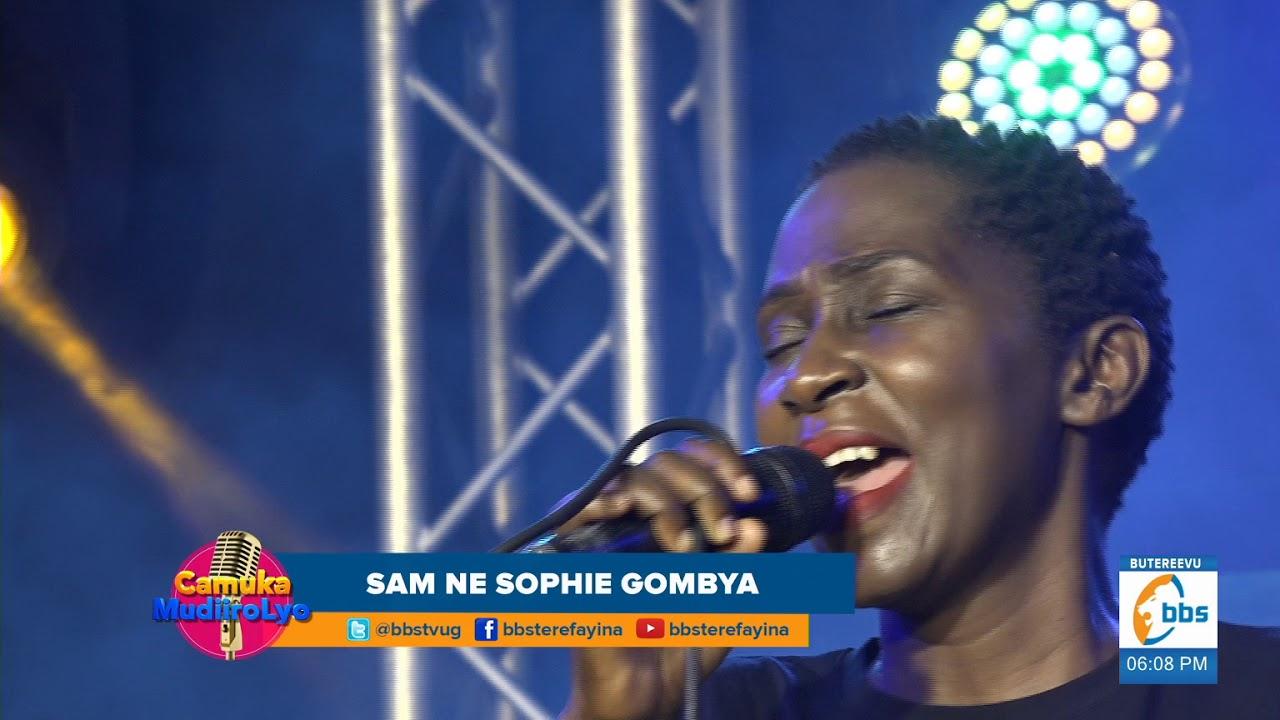 Download Sophie Gombya alumizza ba spare tyre abeewubira ku bbaawe Sam Gombya   Oli Spare Tyre   Camuka