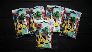 Розпакування 5 пакетиків з сюрпризом іграшкою з серії Трансформери