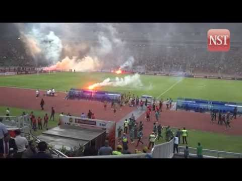 Malaysia-Saudi Arabia match stopped after flares thrown onto pitch