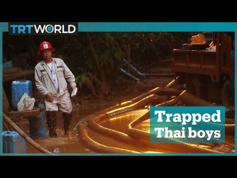 Boys trapped in Thailand cave in race against weather