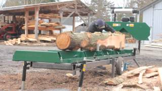 cutting the first log on the new sawmill