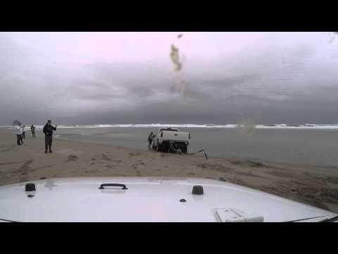 truck stuck in ocean