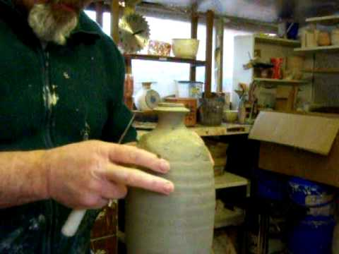 pottery bottle construction and slip design