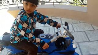 Shubhkarman riding his BMW kids bike