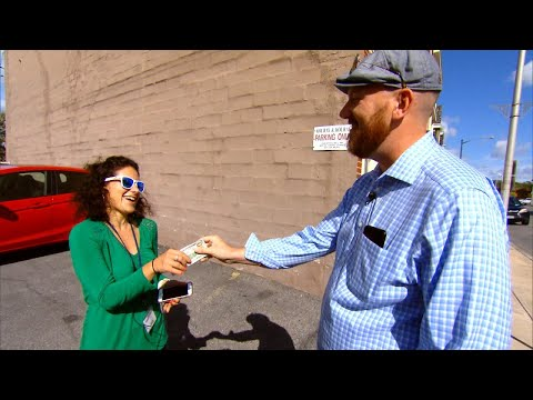 Why This Man is Giving Away $100 Bills on The Street to Strangers