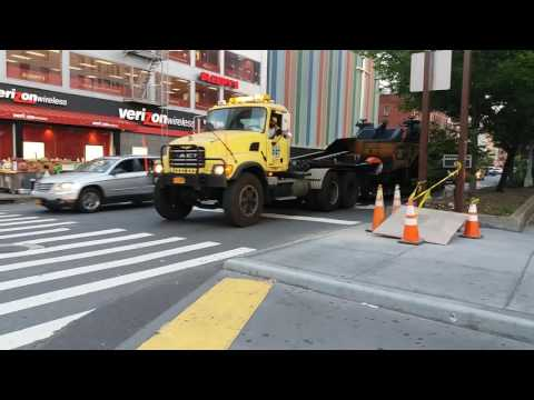 NYC DOT Road Crew Transporting A Milling And Road Resurfacing Machine In Harlem, New York