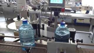 Этикетировочный автомат для тары 5 литров прозрачная этикетка(Оборудование предназначено для аппликации самоклеющихся этикеток на круглые бутылки объемом 5 литров...., 2013-04-24T03:34:43.000Z)