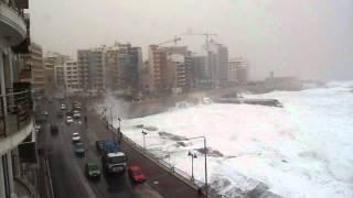 Hurricane in Malta...foaming seas on the beach