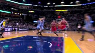Derrick Rose drives through the lane for two tough point