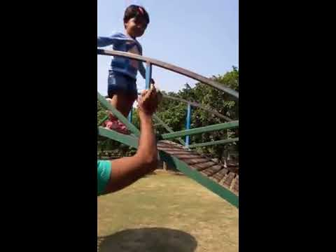 Baby having swing in park