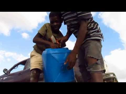 Collecting Water in Hinche