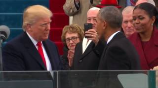 Repeat youtube video Donald Trump arrives on stage to be sworn in as 45th president