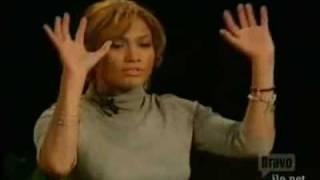Jennifer Lopez dances with a fan
