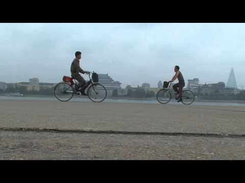 North korea documentary: Juche tower bicycle 5 North Korea Pyongyang