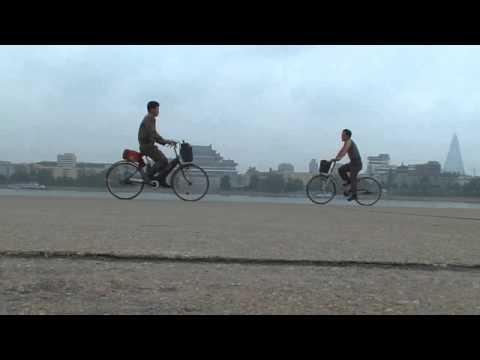 North korea documentary: Juche tower bicycle 5 North Korea Pyongyang