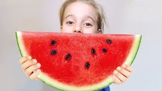 Kids playing with Fruit and colorful watermelon